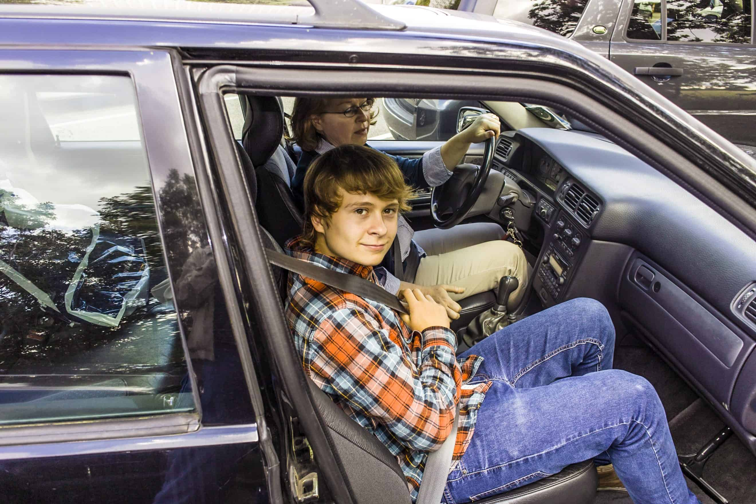 boy using safety belt when entering the car