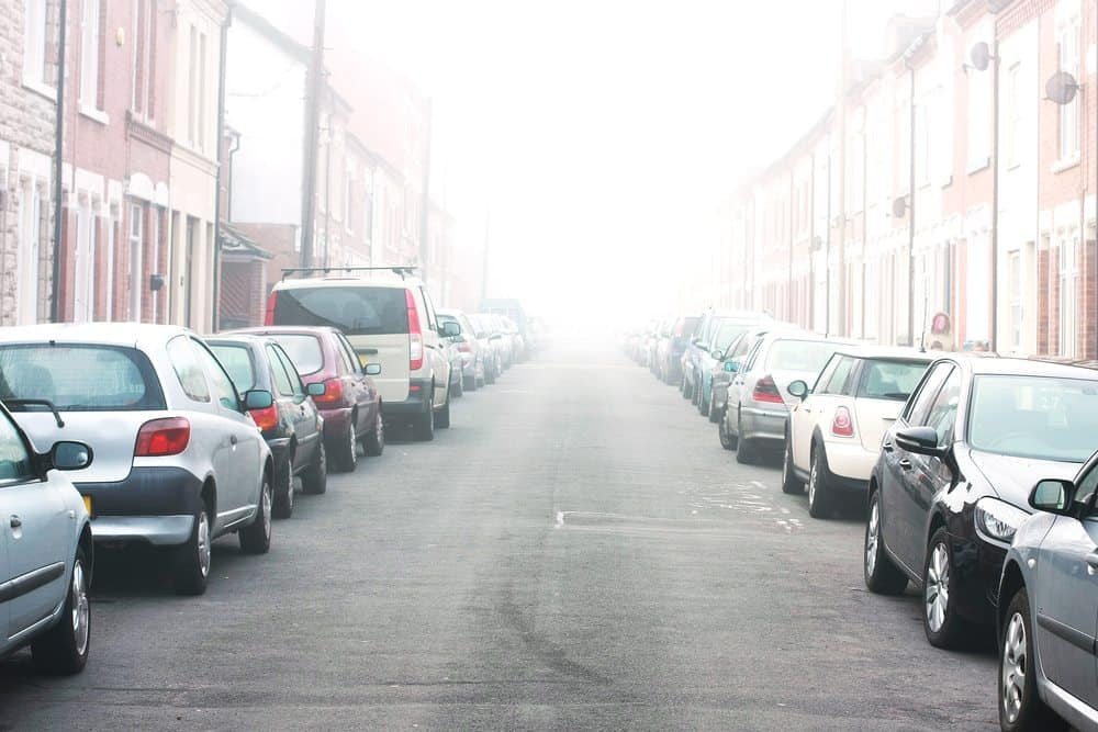 estacionar frente garagem quando